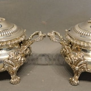 A Pair of George III Silver Covered Tureens, each with a fol...