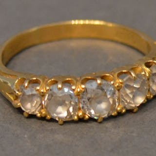 An 18 Carat Gold Five Stone Diamond Ring, the five graduated...