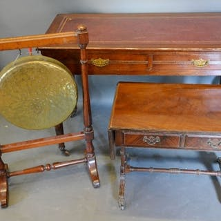 A Late Victorian Writing Table, the tooled leather inset top...