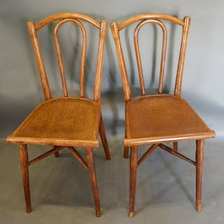 A pair of Bentwood Chairs by Thonet, the shaped backs above ...