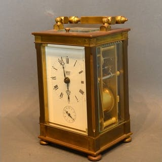 A French Brass Cased Carriage Clock retailed by Dent, London...
