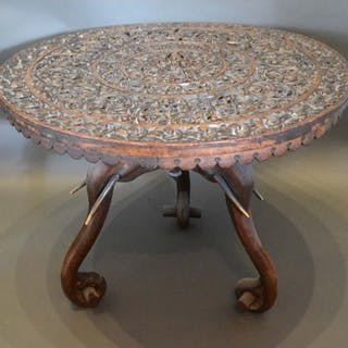 An African Carved Hardwood Occasional Table of Circular Form...