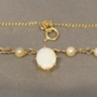 A 9 Carat Gold Necklace set with oval opal and four pearls