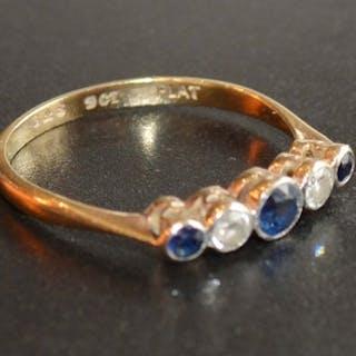 A 9 Carat Gold Sapphire and Diamond Ring set with three sapp...