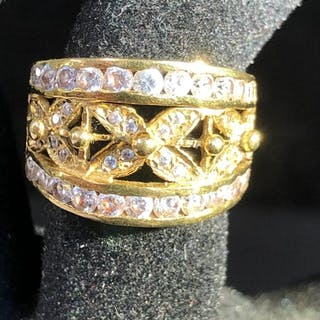 A 18ct gold ring, set with white stones in an openwork X pat...