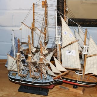 A selection of 4 wooden model yachts.