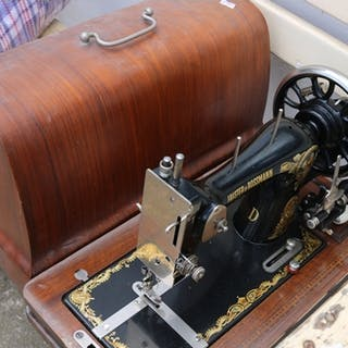A boxed Frister and Rossmann sewing machine.
