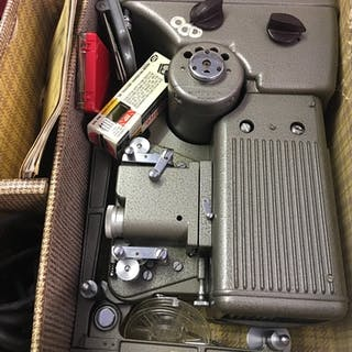 A cased specto 500 projector 16 and 8 mm.