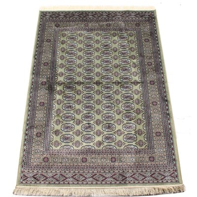A Bokhara style rug with green ground, 79 by 55ins. (200 by ...