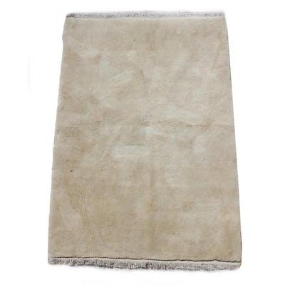 A Gabbeh woollen hand-made rug with beige ground, 56 by 38in...