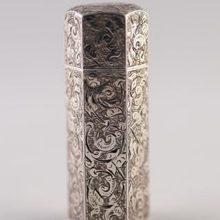 A LATE VICTORIAN SILVER HEXAGONAL SCENT BOTTLE, chased with ...