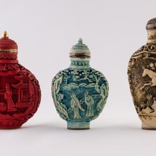 A CHINESE CARVED CINNABAR LACQUER SNUFF BOTTLE with opposing...