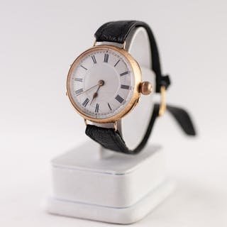 EARLY 20th CENTURY 14K GOLD WRIST WATCH, with white roman di...