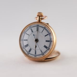 LADY'S 14K GOLD POCKET WATCH with keyless movement, white ro...