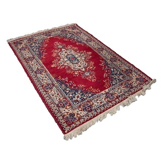 MACHINE WOVEN EASTERN RUG WITH CENTRE MEDALLIONS, ON CRIMSON...
