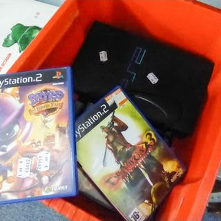 •A PLAYSTATION 2 AND VARIOUS GAMES AND A PISTOL