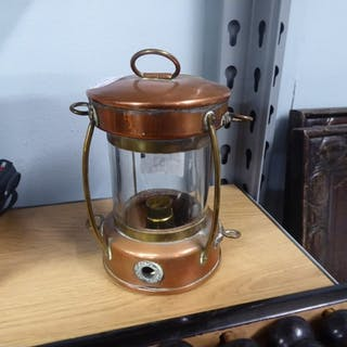 SMALL ELECTRICAL TABLE LAMP IN THE FORM OF A SHIPS COPPER AN...