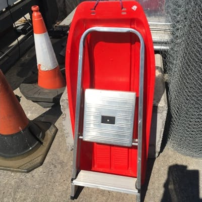 A toy sledge with a step ladder.