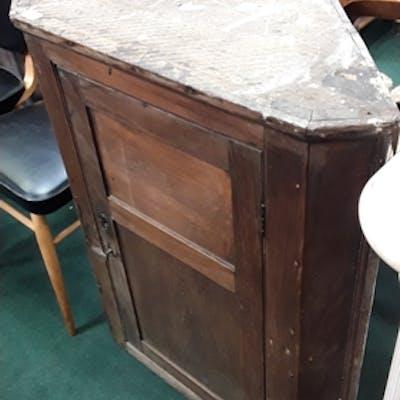 An oak corner cupboard.