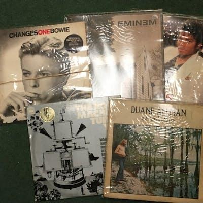 Approximately 100 vinyl records including Bowie, Eminem, Mic...