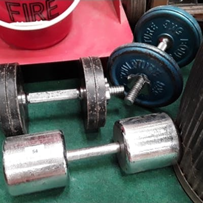 Thre sets of Dumbell weights.