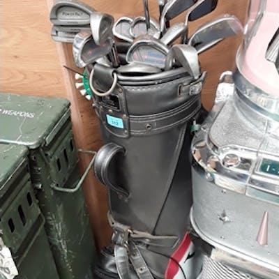 A bag of golf clubs in Lynx bag.
