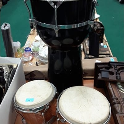A snare drum with a set of bongo drums.
