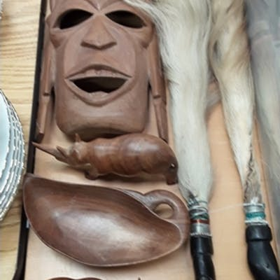A collection of African collectables to include mask.