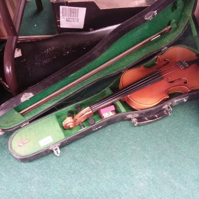 Two violins in cases.