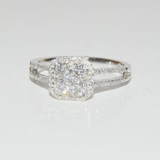 An 18ct white gold halo style diamond cluster ring of 60 poi...