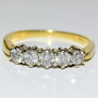 A Diamond five stone Approx 0.75 points set in 18ct gold rin...