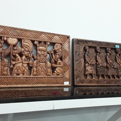 Two decorative carved tribal African plaques.