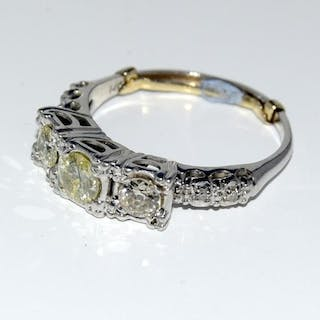 A 14ct white gold three stone diamond ring the central champ...