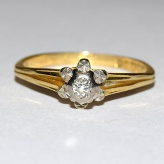 An 18ct gold Diamond solitaire ring.