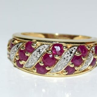 A Ruby and Diamond 14ct gold ring, Size K.