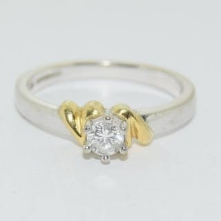 18ct two tone gold diamond solitaire ring - 0.23 ct. Size M.