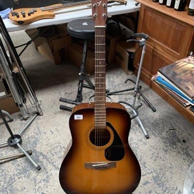 A Yamaha F310 Acoustic Guitar And Case Barnebys