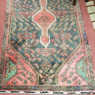 A handmade Iranian Runner with burgundy ground. 367 X 97cms.