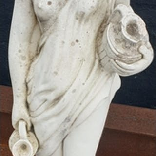 A stone figure of a woman carrying an urn.