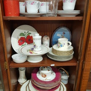 A quantity of Porcelain Items on three shelves.