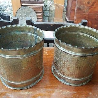 A pair of Brass Bins.