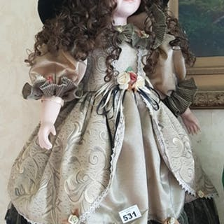A very large Porcelain Doll.