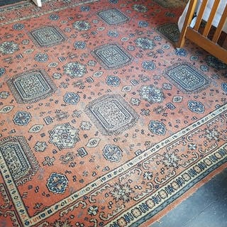 A really good multi bordered Rust ground Rug. 453 cx 315cm.