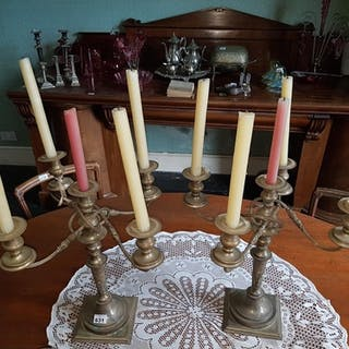 A pair of early 20th Century four branch Plated Candelabra.