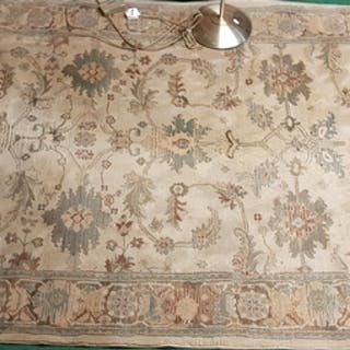 A Cream ground Rug with allover decoration. 160 x 235cm.