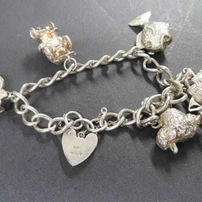 Vintage silver charm bracelet hallmarked London 1976 with 5 ...