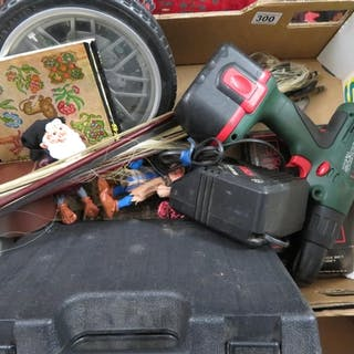 Box containing Bosch drill, clocks, violin bows and records