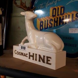 Cognac Hine Ruberoid advertising figure. {36cm H X 24cm W }.