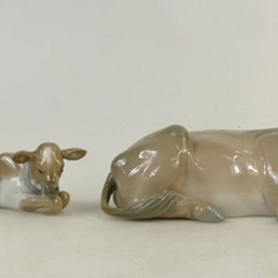 Lladro Cattle Figures: Lladro figures of seated cow and calf...