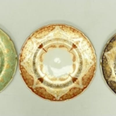 A collection of Royal Doulton gilded cabinet plates: Cabinet...